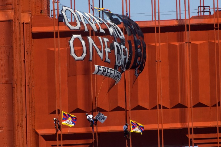 "Three protesters climb the Golden Gate Bridge cables and unfurl a banner reading, ""One World One Dream, Free Tibet"", in protest of the Olympic Torch coming to San Francisco, CA on April 7, 2008. Photo: Jim Herd/SFCitizen"