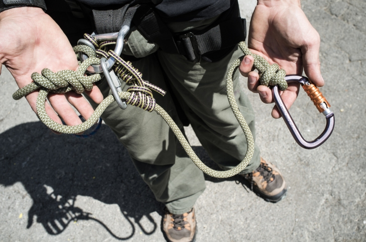 Adjustable lanyard. Notice the four components: barrel knot restricts carabiner movement, prusik for adjustment, screw link tends prusik, eight follow-thru tied directly to central point on harness.