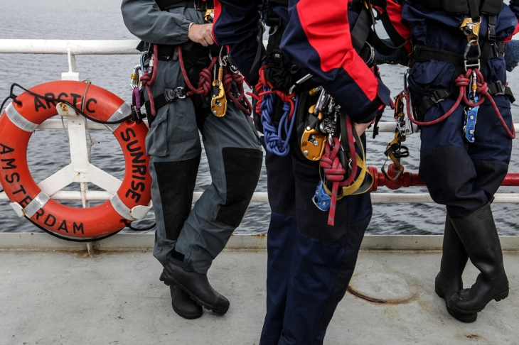Climbers with Greenpeace on the Arctic Sunrise in the Barents Sea. Photo: Igor Podgorny, July 2012