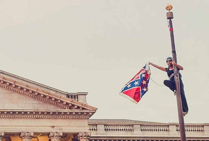 Bree Newsome takes down the confederate flag. Photo: Adam Anderson/Reuters Media Express