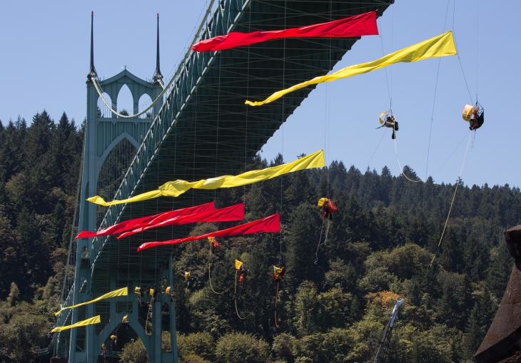 Climbers suspend themselves under the St. Johns Bridge in Portland, OR and join kayaktivists in an effort to block the Shell leased icebreaker, MSV Fennica from meeting with the rest of Shell's Arctic drilling fleet on July 29, 2015. Photo: Tim Aubry/Greenpeace