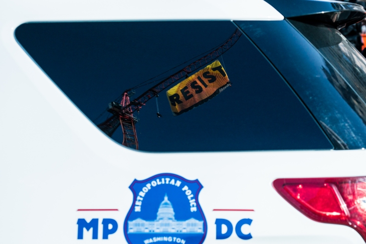 A reflection of the 'Resist' banner that was displayed in view of the White House on January 25, 2017.